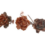 light-blue coloured rose, fireworked rose, and ageed copper rose