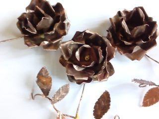 three ageed copper anniversary roses