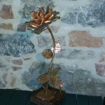 Handmade copper rose (ageed and natural copper coloured petals) on wooden base